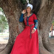 A medieval dress. The chemise is made of natural handkerchief linen and the dress in crimson wit...