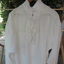Reproduction of a c.1740 linen ruffled shirt. All ruffles have hand rolled and hand stitched hem...