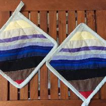 These potholders are made from all scrap linens, some of which is hand dyed. I intentionally mad...