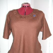 Bias cut middle weight linen blouse with smocked neckline.