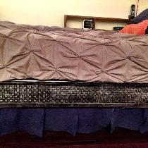 New linen bed skirt composed of double faced linen panels....you can see a box peaking out at le...