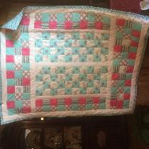 throw cover size girls quilt for a special little girl finished it with in the ditch.