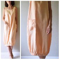 Bubble dress with single pocket made with Apricot Ice - middle weight.