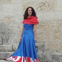 This dress was made from blue linen (6yds) with red and white linen stripes along the hem. I wor...