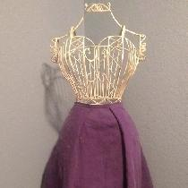 Simple pleated skirt made from medium weight royal purple. Hits just below the knee with a flatt...