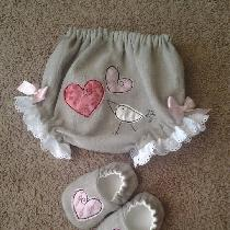 Natural linen baby bloomers and shoes with appliqué embellishment.