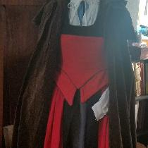 Harley Quinn inspired Renn Faire dress made from Firecracker red trimmed with Black, with a kirt...