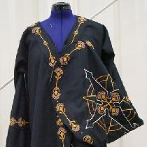 Hand embroidered with cotton thread on black linen and appliqued over black wool.