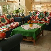 Sunroom seating set by Nabila's Creations upholstered with blue linen from Fabric Store.