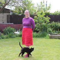 Linen A-line skirt with ribbon trim plus photo bombing cat.   Fully lined (not linen).   Lovely...