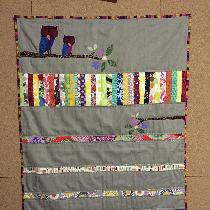 This is a baby quilt made with medium weight linen.  It is my own design and I also used scraps...