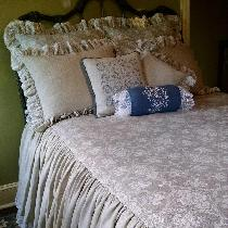 Skirted coverlet bedding set, made entirely of linen, with lace accents and embroidery. The cove...