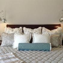 beautiful bed hand quilted bedspread. Silk box pleat on Euro's. Beautiful bed roll with pleat on...