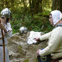 Reviewing the map.  Gambeson, under tunic, braies (not visible), arming cap (not visible), and l...