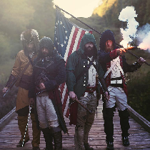 I am the Revolutionary War patriot on the right, holding the flag. My coat is handmade by myself...