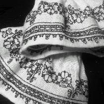 Blackwork cuffs embroidered entirely by hand on IL019 Bleached linen. The pattern is a row of lo...