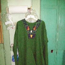This is my idea of a 12th century Northern German tunic.  It is entirely handsewn in green and p...