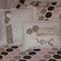 Pillows w/trim and rosettes in white and rustic linen.