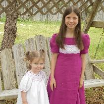 Here are my daughters wearing their Easter dresses from last year.  Both are smocked.  The older...