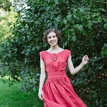 A simple summer dress made from ILO19 in English Rose. The dress is simple, shaped rectangles se...