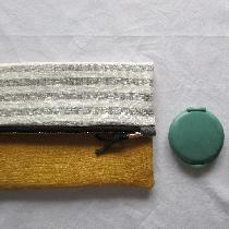 100% Linen Fold-Over-Clutch. Made with yellow linen on the front, gray striped linen on the back...