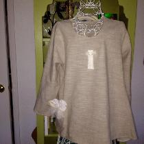 Light weight linen  blouse in Wheat. I added a few bits of lace and vintage buttons. The pattern...