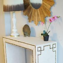 Custom made console table wrapped in linen with nail heads in a Greek Key design!