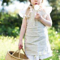 I made a children's apron in 4C22 Mixed Natural. The photo shoot was done over the Summer in bea...
