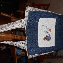 Baby bag done in denim with pockets, magnetic closure, and cross stitch applique. The cross stit...