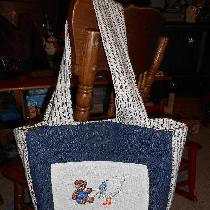 Gaye, Baby bag done in denim with pockets, mag...