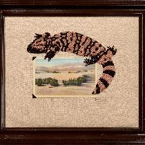 I have combined a vintage postcard with my hand-embroidery on linen fabric.  The gila monster is...