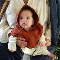 I created a baby tunic and a baby liripipe hood out of linen. The tunic is IL020 natural and the...