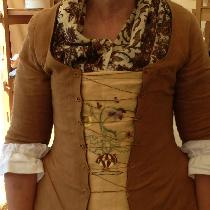 18th C English Shortgown and hand embroidered stomacher I made for a customer.  She looks stunni...