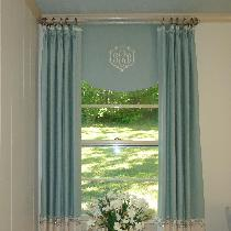 The window treatments for this room were made in a color blocked style with a washed linen for t...