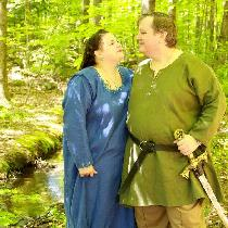 Viking women's kirtle and men's tunic and trousers.  The kirtle is decorated with hand embroider...