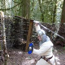 Man-at-Arms practicing at the pel. Quilted linen gambeson, braies, arming cap, and lining to hos...