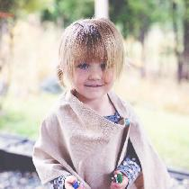 Simple, yet stylish, this lovely linen poncho for little girls, leaves those little hands free t...