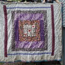 the  front of a king size quilt I made in 2016  all out of used material items bought at use sto...