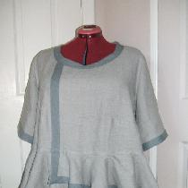 Tunic with asymmetric peplum in IL019 Drizzle trimmed with IL019 Monument.