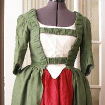 A 1770s robe a l'anglaise in Vineyard Green and petticoat in Firecracker Red. I was short on fab...