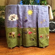 This is one side of a bassinet skirt. There are a total of 8 panels, each with a different scene...