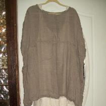 Slip dress with lots of ruffles, different types of linen, and over shirt made from open weave l...
