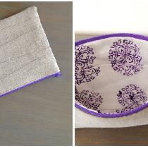 This zipper pouch is made from pieced scraps of natural rustic linen on the outside and mid-weig...