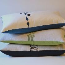 Zoe, Hand silk-screened pillows made from med...