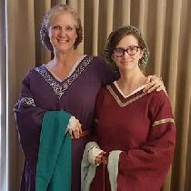 Medieval Bliaut dresses.  Made with IL019: Royal Purple with Sphinx for sleeve lining, and Wild...