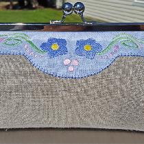 An original design, a classic full linen clutch with custom embroidery using wonderful linen fro...